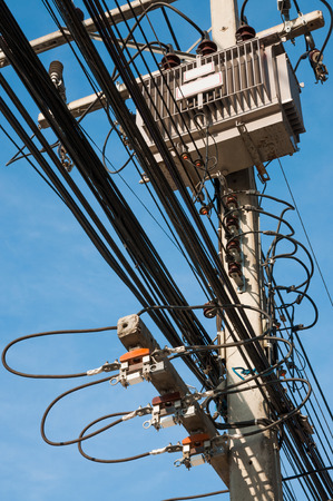 electrical power: The chaos of cables, wires and power lines. Stock Photo