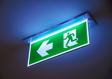 Fire exit ,green emergency exit sign. Stock Photo - 39062630