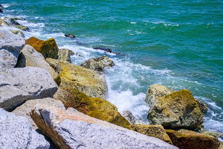 Waves breaking on a stony beach.