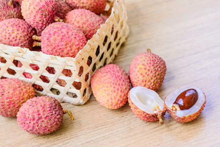 leechee: Fresh lychee in bamboo basket on a wooden background