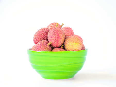 litchee: Ripe lychee fruit in green bowl against white