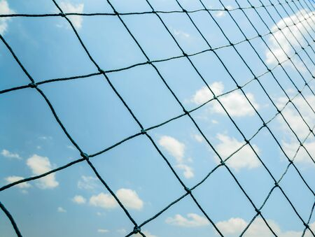 mesh fence: Seamless mesh fence in football stadium on blue sky.