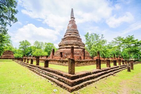 thai temple: The ruin of the temple Wat Phra Kaeo in Kamphaeng Phet Historical Park,Thailand. large royal temple in town centre. Thailand Stock Photo