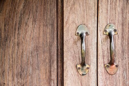 furniture hardware: Rustic wooden doors background with old handles