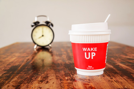 o'clock: Alarm clock and coffee cup, Eight oclock in the morning.