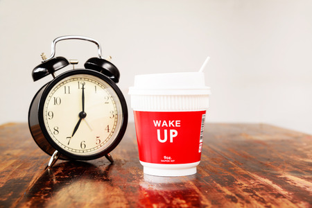 Alarm clock and coffee cup, Seven o'clock in the morning Imagens - 45125054