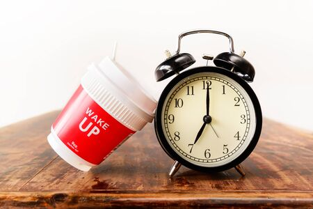 seven o'clock: Alarm clock and coffee cup, Seven oclock in the morning
