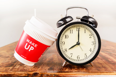 Alarm clock and coffee cup, eight o'clock in the morning Imagens - 45125288