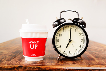 Alarm clock and coffee cup, Seven oclock in the morning