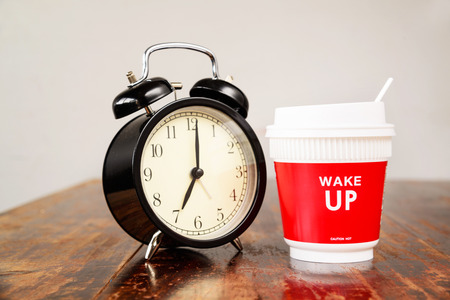 o'clock: Alarm clock and coffee cup, Seven oclock in the morning