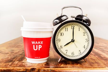 seven o'clock: Alarm clock and coffee cup, Eight oclock in the morning.