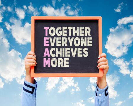 achieves: Together Everyone Achieves More - TEAM Concept on chalkboard.