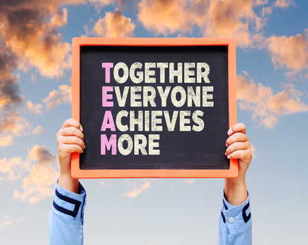 everyone: Together Everyone Achieves More - TEAM Concept on chalkboard.