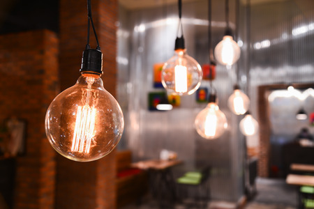 Beautiful lamps on ceiling in restaurant. Archivio Fotografico