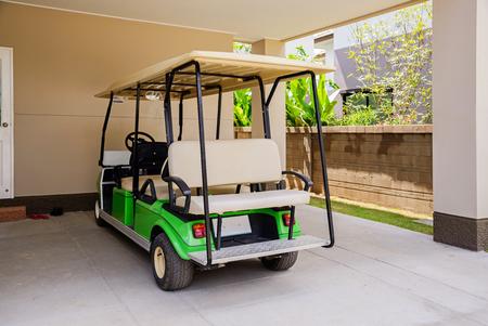 golf cart: Golf cart in home.