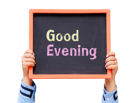 good evening: Hands holding blackboard with Good evening message Stock Photo