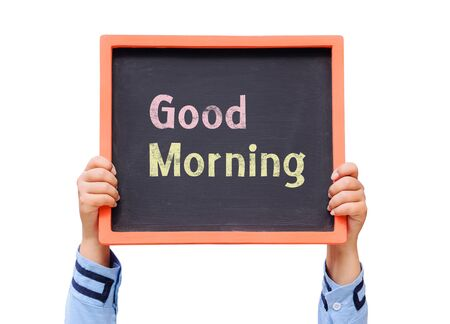 good work: Hands holding blackboard with Good morning message Stock Photo