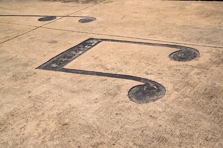 creatively: Musical notes creatively drawn on a road. Stock Photo