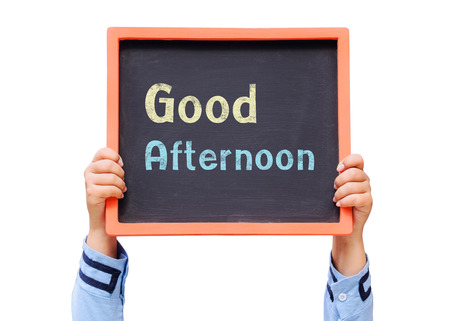 Hands holding blackboard with Good afternoon message 写真素材