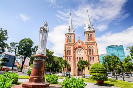 HO CHI MINH CITY, VIETNAM - NOVEMBER 2: Virgin Mary statue in front of Notre-Dame Cathedral landmark in Ho Chi Minh City, Vietnam on November 2, 2015. Ho Chi Minh is a popular tourist destination of Asia.