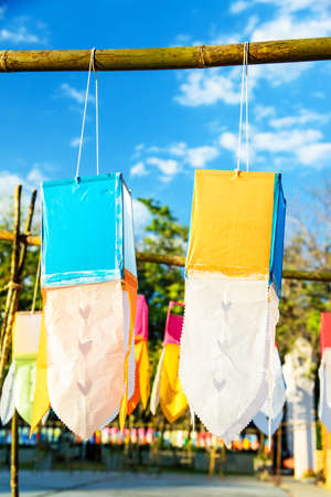 chiangmai: Paper lanterns on blue sky in Yee Peng Festival, Loy Krathong celebration in Chiangmai, Thailand. Stock Photo