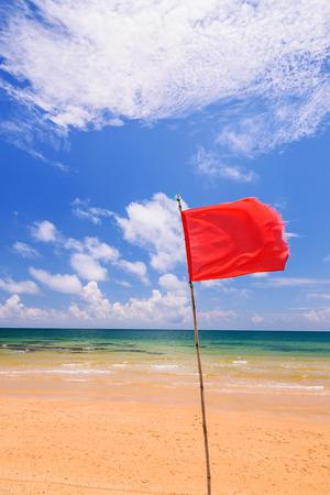 oceanside: Red warning flag on beach, Thailand.
