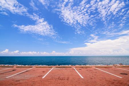 Empty space parking lot on the sea coast Standard-Bild