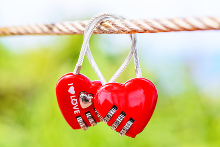 Two Heart Shaped Love Padlocks On The Bridge As A Symbol Of Eternal