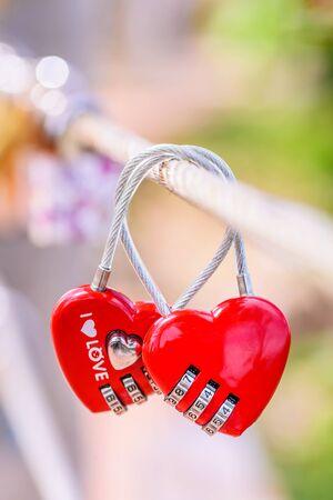 Two Heart Shaped Love Padlocks On The Bridge As A Symbol Of Eternal