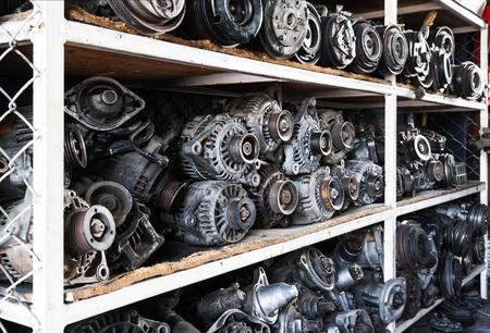 Old car alternators on shelf. Imagens - 50234638