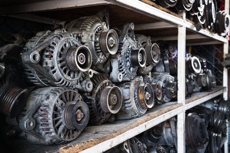 Old car alternators on shelf. Stock Photo - 50234644