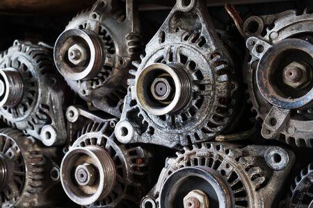 aluminium: Old car alternators on shelf.