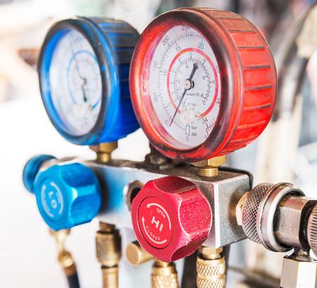 refrigerator: Refrigerator pressure gauges, Selective focus.