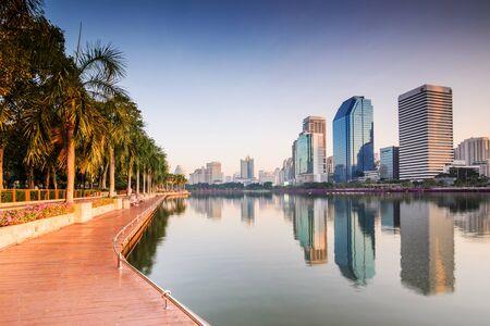 bangkok: Bangkok Building with Reflection at sunrise, Benjakiti Park ,Thailand.