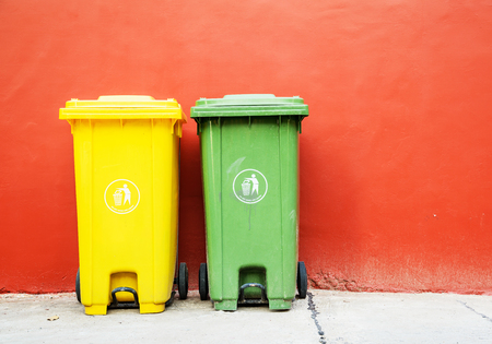 wheelie bin: Large green and yellow wheelie bins for Recycle Materials