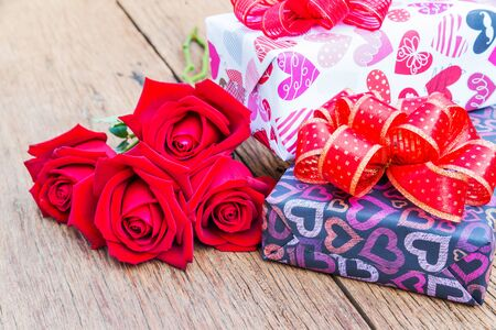 boxs: Red roses and gift boxs on wooden background, Valentines Day background, Wedding day.