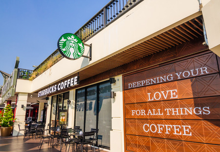 THAILAND - FEBRUARY 5: Starbucks Coffee coffeehouse at Maharaj Pier, Chao Phraya riverside on February 5, 2016 in Bangkok, Starbucks is the largest coffeehouse company in the world.