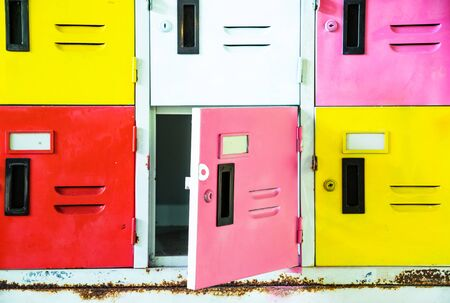lockers: Rows of different colors metal lockers Stock Photo