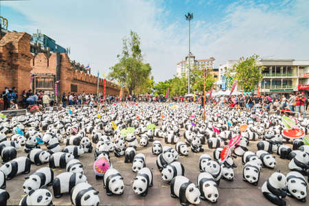 wwf: Chiang Mai, Thailand - March 19, 2016 : 1600 Pandas World Tour in Thailand at Tha Phae Gate in Chiang Mai. 1600 paper marche pandas are made from recycled materials, Campaign by WWF for promoting animal preservation in Thailand.
