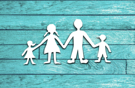 cut paper: Happy family paper cut on wood background Stock Photo