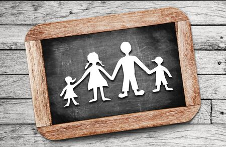 cut paper: Happy family paper cut on chalkboard background
