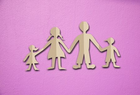 cut paper: Happy family paper cut on cement wall background