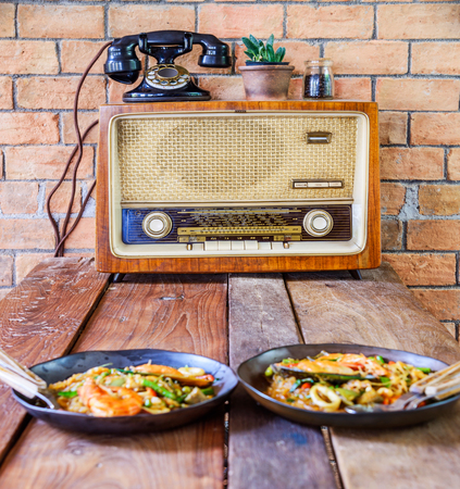 lunch table: Old retro radio on wood table in lunch room