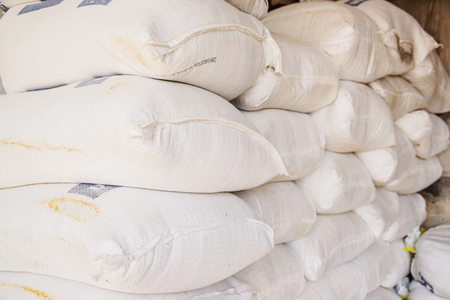 dirt ground: Pile of fertilizer bags, Stacks of fertilizer bags In Warehouse. Stock Photo