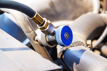 servicing: Car refilling air condition, Servicing car air conditioner in vehicle service.