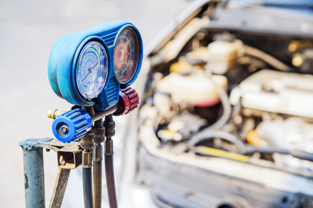 refilling: Car refilling air condition, Servicing car air conditioner in vehicle service.
