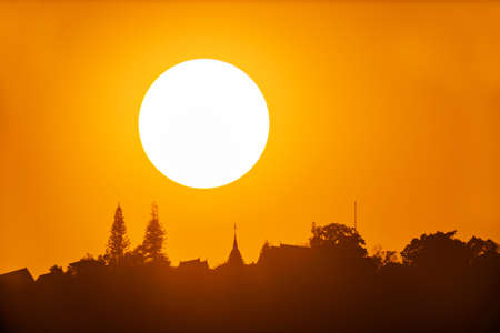 Big sun on sunset and Wat Phra That Doi Suthep temple is tourist attraction of Chiang Mai, Thailand, Asia.