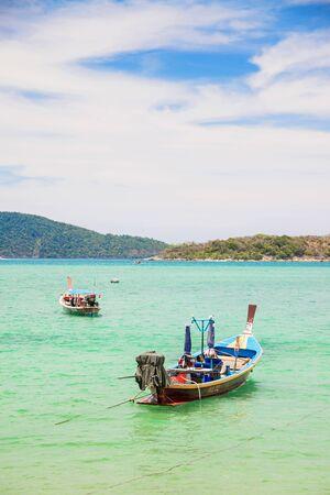 phuket province: PHUKET, THAILAND - MAY 6, 2016: Traditional longtail boat at Andaman sea, Phuket province, Thailand.