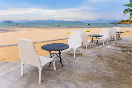 escape key: Tables and chairs on the beach