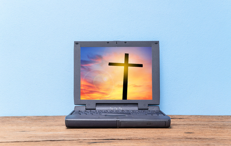 christianity palm sunday: Cross on sunset in old laptop, Concept conceptual black cross, Gospel concept.